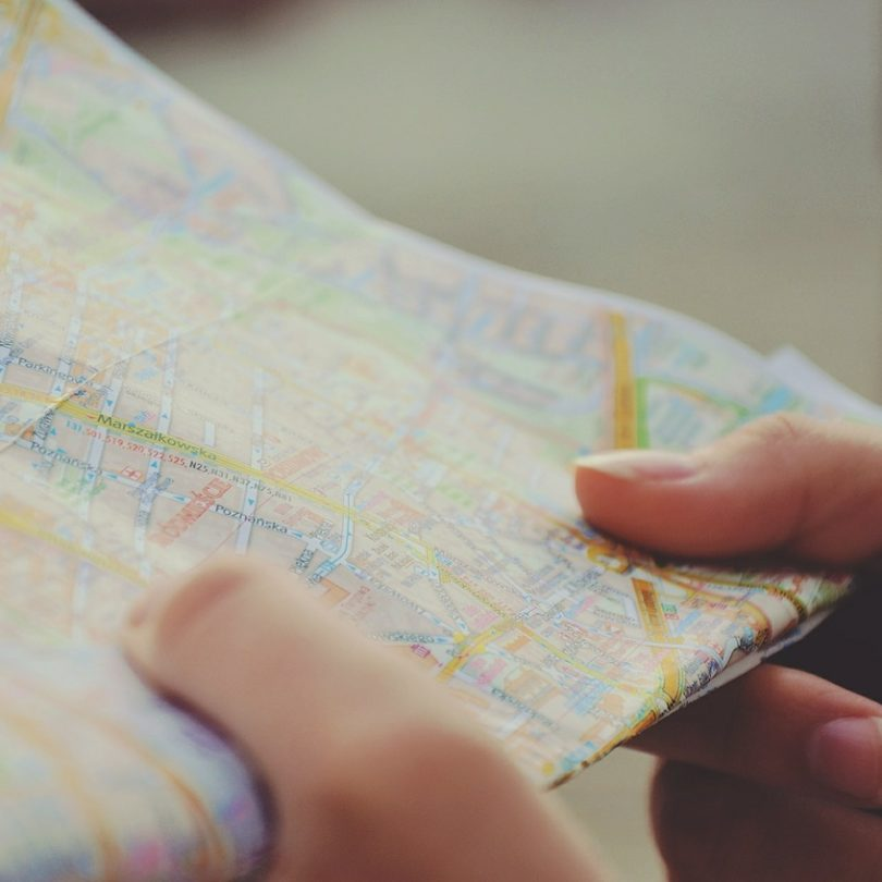 Personal holding a map